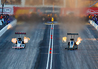 Feb 24, 2018; Chandler, AZ, USA; NHRA top fuel driver Steve Torrence (left) races alongside Tony Schumacher during qualifying for the Arizona Nationals at Wild Horse Pass Motorsports Park. Mandatory Credit: Mark J. Rebilas-USA TODAY Sports