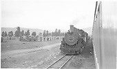 Head-on view of D&amp;RGW #493 with a westbound freight passing passenger train, as seen from the passenger.<br /> D&amp;RGW  Chama, NM  Taken by Welch, Ronald - 5/30/1955