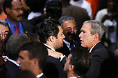 Washington, DC - July 20, 2006 -- United States President George W. Bush shakes hands with spectators during the National Association for the Advancement of Colored People's (NAACP) 97th Annual Convention.  President Bush spoke about the Voting Rights Act, Social Security, and Medicare.<br /> Credit: Evan F. Sisley - CNP