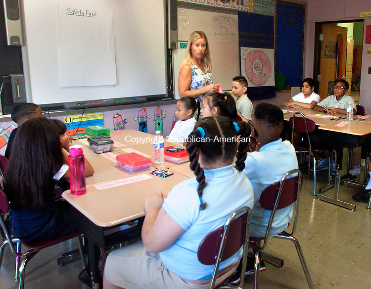 WATERBURY, CT 12 AUGUST 2015 -082615DA05 Amy Neible 4th-grade teacher of Generali Elementay School in Waterbury talks to her students on the first day back to school on Wednesday. <br /> Darlene Douty Republican-American