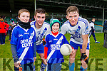 Jack and Ronan Butler, St. Mary's fans with players Daniel Daly and Denis Daly Cahersiveen supporters enjoying the football intermediate club championship semi-final, at the Gaelic Grounds, Limerick on Sunday last.