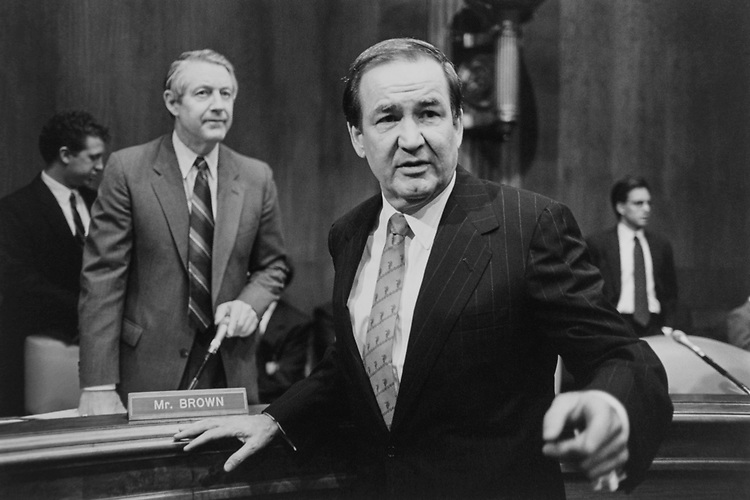 Senate Judiciary Subcommittee on Constitution Chairman, Sen. Hank Brown, R-Colo., greets Former White House Director of Communications Pat Buchanan before his testimony during a press conference on term limits on Jan. 26, 1995. (Photo by Laura Patterson/CQ Roll Call via Getty Images)
