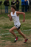 Michael Karls digs deep nearing the finish of the Class 3 boys race enroute to victory and the second fastest time ever for a runner at the state meet, at the 2014 MSHSAA State Cross Country Championship in Jefferson City, MO. Saturday, November 8.