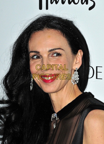 L'Wren Scott, partner of Mick Jagger &amp; former model, is found dead in her New York home on in an apparent suicide on March 17th, 2014.<br /> L'Wren Scott<br /> Harper's Bazaar Woman of the Year Awards at Claridge's Hotel, London, England.<br /> October 31, 2012 <br /> headshot portrait black diamond earrings red lipstick  sleeveless  <br /> CAP/BF<br /> &copy;Bob Fidgeon/Capital Pictures