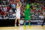 Wisconsin Badgers guard Ben Brust (1) scores his school record 208 3-pointers during the third-round game in the NCAA college basketball tournament against the Oregon Ducks Saturday, April 22, 2014 in Milwaukee. The Badgers won 85-77. (Photo by David Stluka)