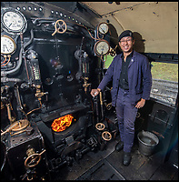 BNPS.co.uk (01202)558833<br /> Pic: PhilYeomans/BNPS<br /> <br /> New blood - Nathan Au(27) has just qualified as a new driver after an 8 year apprenticeship on the Swanage Railway.<br /> <br /> Growth Industry - Britain's enduring love affair with steam trains has led to a critical shortage of drivers, 56 years after the infamous Beeching Axe was supposed to have fallen.<br /> <br /> More steam train's are running today than at anytime since Dr Beechings drastic cut in 1963 - with over 150 steam heritage railways and museums attracting 13 million visitors a year.<br /> <br /> One of the most popular heritage railways in the country has put out an SOS for steam drivers - as so many of its stalwarts are retiring.<br /> <br /> Swanage Railway in Dorset has 42 steam drivers on their books, but the majority are in their 60s or older and likely to step down in the coming years.<br /> <br /> They need to train up to 40 drivers over the next five years to replace them and meet their expanding service, which attracts over 200,000 visitors each year.<br /> <br /> To fill the void, a group of enthuisastic young volunteers are being taught the skill, a process which can take up to a decade.<br /> <br /> The Heritage Railway Association, which oversees them, says some of their railways have a 'more pressing need for new blood'.