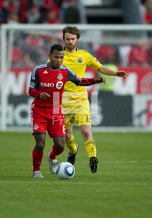 23 April 2011: Columbus Crew midfielder/forward Eddie Gaven #12 and Toronto FC midfielder Julian de Guzman #6 in action during a game between the Columbus Crew and the Toronto FC at BMO Field in Toronto, Ontario Canada..The game ended in a 1-1 draw.