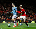 Phil Foden of Manchester City and Brandon Williams of Manchester United during the Carabao Cup match at Old Trafford, Manchester. Picture date: 7th January 2020. Picture credit should read: Darren Staples/Sportimage