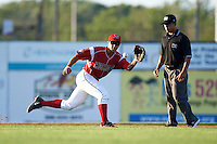 Batavia Muckdogs second baseman Mike Garzillo (11) catches a throw as umpire Jhonatan Biarreta looks on during a game against the Aberdeen Ironbirds on July 14, 2016 at Dwyer Stadium in Batavia, New York.  Aberdeen defeated Batavia 8-2. (Mike Janes/Four Seam Images)