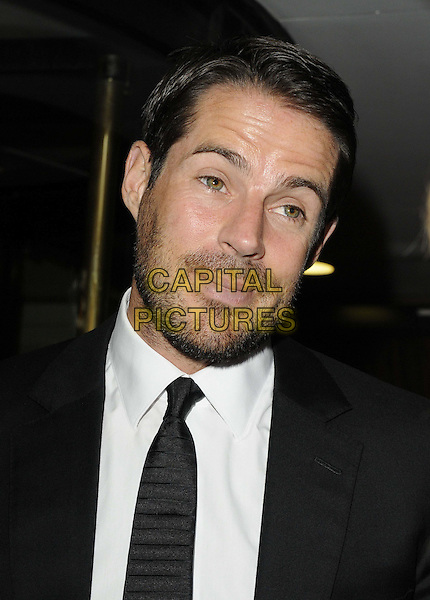 Jamie Redknapp.The 'A Night of Champions' inaugural fundraising ball for the Mo Farah Foundation, Grosvenor House Hotel, Park Lane, London, England..September 1st, 2012.headshot portrait black white tie stubble facial hair funny .CAP/CAN.©Can Nguyen/Capital Pictures.