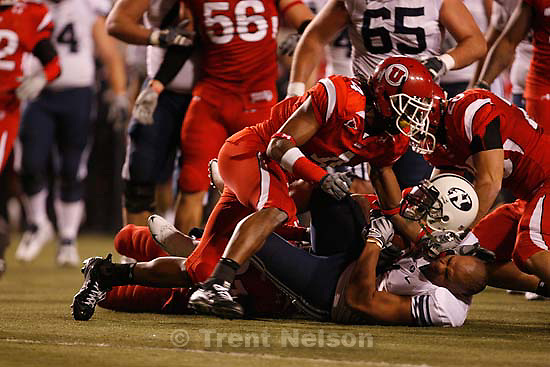 Salt Lake City - Utah vs. BYU college football Saturday, November 22, 2008 at Rice-Eccles Stadium. BYU RB Fui Vakapuna (1) tackled by Utah defensive back Terrell Cole (21), loses his helmet. Utah running back Matt Asiata (4)