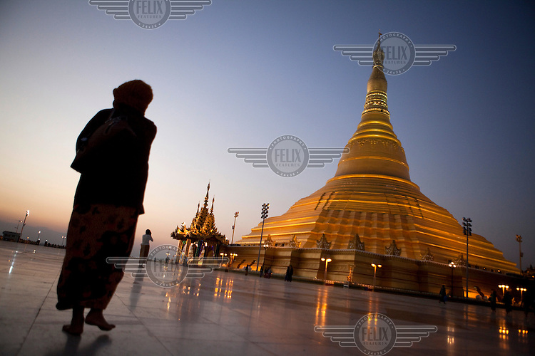 Visitors walk near the replica of the famous Shwedagon Pagoda in Naypyitaw, the new capital of Burma (Myanmar) since November 2005.