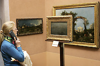 "Una turista osserva il dipinto ""Gondole sulla Laguna"" di Francesco Guardi, nel Museo Poldio Pezzoli a Milano.<br /> A tourist admires the ""Gray Lagoon"" painting by Francesco Guardi in the Museo Poldi Pezzoli in Milan.<br /> UPDATE IMAGES PRESS/Riccardo De Luca"