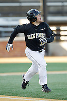 Nate Mondou (10) of the Wake Forest Demon Deacons hustles down the first base line against the Georgetown Hoyas at Wake Forest Baseball Park on February 16, 2014 in Winston-Salem, North Carolina.  The Demon Deacons defeated the Hoyas 3-2.  (Brian Westerholt/Four Seam Images)