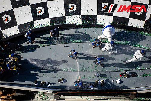#10 Konica Minolta Cadillac DPi-V.R. Cadillac DPi, DPi: Renger Van Der Zande, Ryan Briscoe, Scott Dixon, Kamui Kobayashi, #77 Mazda Team Joest Mazda DPi, DPi: Oliver Jarvis, Tristan Nunez, Olivier Pla, and #5 Mustang Sampling Racing / JDC-Miller MotorSports Cadillac DPi, DPi: Sebastien Bourdais, Loic Duval, Joao Barbosa celebrates