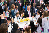 United States President Donald J. Trump colors with children during the White House Easter Egg Roll at the White House in Washington, D.C. on April 22, 2019. <br /> Credit: Kevin Dietsch / Pool via CNP