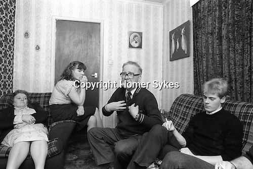 Derry Northern Ireland Londonderry. 1983. The Quigley family at home. Mrs Quigley, daughter Olive, Mr Quigley and Gerard, brother of Bobby Quigley who is an informer for the RUC Royal Ulster Constabulary.