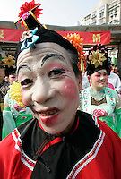 Citizens of Macau dress up in traditional Chinese. The ex-Portuguese colony of Macau in South China is a mecca for gamblers in Asia and especially China and makes more money that Las Vegas.