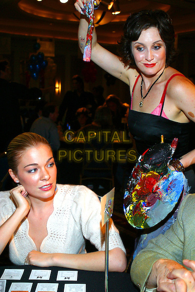 LEANNE RIMES & RACHEL KICE.Celebrities playing Monopoly at Hilton Suites- Nashville, Tennessee..September 28th, 2005.Photo Credit: Randi Radcliff/AdMedia/Capital Pictures.Ref: RR/ADM/CAP.half length board game paint brush artist.www.capitalpictures.com.sales@capitalpictures.com.© Capital Pictures.