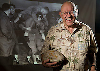 John Andrews '51 holds both the key to the city of Fresno and the vintage football commemorating the 1948 season. He is pictured over his right shoulder (the coach is looking at him.) Occidental College Raisin Bowl game 60th reunion of the 1948 football team, November 14, 2008. Homecoming weekend. (Photo by Marc Campos, College Photographer, Occidental College)