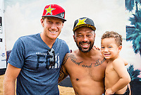 North Shore, Oahu, HAWAII - (Friday, Nov. 15, 2013) Sunny Garcia (HAW) the winner of the Clash of Legends with his grandson Sunny and former Triple Crown winner bede Durbidge (AUS).-- A late afternoon glass-off coupled with excellent overhead waves saw underdog Brazilian Jesse Mendes (world rank: 63) steal the show at the REEF Hawaiian Pro today, when he posted the highest 2-wave combination of the event: 17.9 points out of 20 (9.2 and 8.7). Mendes, 20, from Sao Paulo, was close to flawless on his backhand attack of the famously fun break of Haleiwa. The REEF Hawaiian Pro is the first stop of the $960,000 Vans Triple Crown of Surfing.<br /> The contest has until November 23 to run four full days of competition where 128 of the world's best surfers will compete for critical ASP Prime points and a share of $250,000 prize money. The winner of this event will take home $40,000 and an early lead on the 2013 Vans Triple Crown series ratings. <br /> <br /> A bad day turned good for 6-time Vans Triple Crown champion Sunny Garcia (HAW) today, bowing out of the main event but getting the better of a fun reunion with three other legends of the sport to win the exhibition REEF Clash of the Legends. The $10,000 first prize definitely helped to lift his mood. His former tour traveling partner Kaipo Jaquias (HAW) was second; Michael Ho (HAW) was third; and California's Brad Gerlach (USA) was fourth. This was Garcia's second &quot;Clash&quot; title.Photo: joliphotos.com