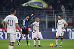 Radja Nainggolan and Alberto Cerri of Cagliari look bemused as Andrea Ranocchia of Inter runs past punching the air following Inter's 4th goal during the Coppa Italia match at Giuseppe Meazza, Milan. Picture date: 14th January 2020. Picture credit should read: Jonathan Moscrop/Sportimage