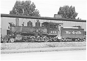 Fireman's-side view of D&amp;RGW #318 beside Montrose engine house.<br /> D&amp;RGW  Montrose, CO