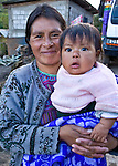 Mother holds her daughter in a village outside Todos Santos Cuchumatan, Western Highlands, Guatemala