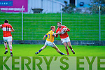Dáithí Ó Géibheannaigh (Dingle) in action againest Maurice Corridon (Feale Rangers) in The Garvey's SuperValu Senior County Championship Quarter Final at Austin Stack park, on Saturday