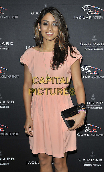 Isa Tara Guha.The Jaguar Academy Of Sport Annual Awards 2011, Savoy hotel, the Strand, London, England..November 27th, 2011.half length black clutch bag pink dress.CAP/CAN.©Can Nguyen/Capital Pictures.