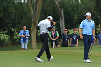 Phachara Khongwatmai (Asia) birdies on the 7th green during the Saturday Foursomes of the Eurasia Cup at Glenmarie Golf and Country Club on the 13th January 2018.<br /> Picture:  Thos Caffrey / www.golffile.ie