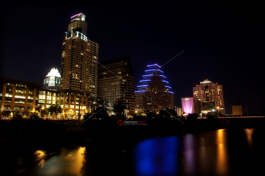 A colorful reflection on beams on Town Lake from the Austin Skyline in downtown Austin, Texas, USA