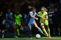 Seattle, WA - Sunday, May 22, 2016: Seattle Reign FC midfielder Beverly Yanez (17) pushes off the Chicago Red Stars defender Arin Gilliland (3) during a regular season National Women's Soccer League (NWSL) match at Memorial Stadium. Chicago Red Stars won 2-1.