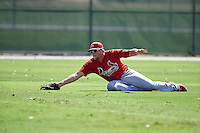GCL Cardinals left fielder Walker Robbins (16) makes a diving catch during the first game of a doubleheader against the GCL Marlins on August 13, 2016 at Roger Dean Complex in Jupiter, Florida.  GCL Cardinals defeated GCL Marlins 4-2 in a continuation of a game originally started on August 8th.  (Mike Janes/Four Seam Images)