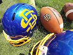 BROOKINGS, SD - AUGUST 11: A helmet and football with South Dakota State University logo outside Monday afternoon at the Jacks Media Day in Brookings. (Photo by Dave Eggen/Inertia)