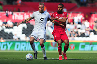 Mike van der Hoorn of Swansea City is fouled by Lewis Grabban of Nottingham Forest during the Sky Bet Championship match between Swansea City and Nottingham Forest at the Liberty Stadium in Swansea, Wales, UK. Saturday 14 September 2019