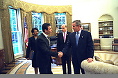 United States President George W. Bush says goodbye to Danish Prime Minister Anders Fogh Rasmussen of Denmark in the Oval Office of the White House in Washington, DC on Thursday, May 8, 2003. Also present are National Security Advisor Condoleezza Rice and Denmark's Ambassador to the US Ulrik Federspiel. <br /> Mandatory Credit: Eric Draper / White House via CNP