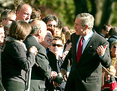 Washington, D.C. - November 25, 2006 -- United States President George W. Bush has an animated conversation with staff members and their families after he and first Lady Laura Bush arrived on the South Lawn of the White House after spending the Thanksgiving Day week-end at Camp David on Saturday, November 25, 2006.  <br /> Credit: Ron Sachs - Pool