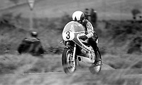 John Williams, British, rider, racing motorcyclist competing in 1973 Ulster Grand Prix. He won the 250, 350, and 500 cc races. He was a five-time winner of the North West 200 race in Northern Ireland and a four-time winner at the Isle of Man TT.[2] Williams died from injuries suffered while competing in the 1978 Ulster Grand Prix in Northern Ireland. 197308180571JW2<br />