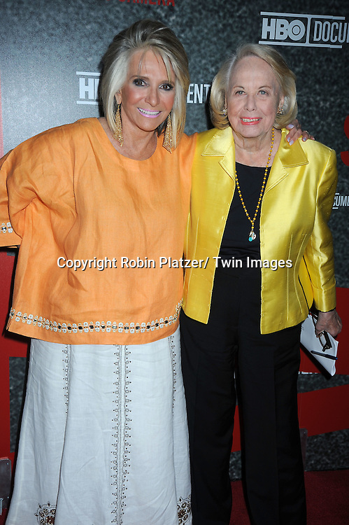 "Sheila Nevins and Liz Smith  posing for photographers at the Ron Galella HBO Documentary ""Smash His Camera"" on June 1, 2010 at the Museum of Modern Art in New York City."