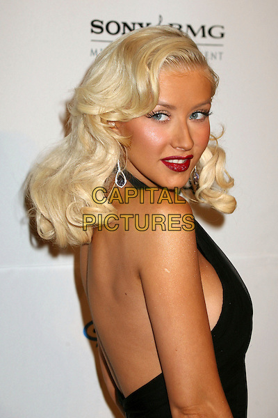 CHRISTINA AGUILERA.Clive Davis 2007 Pre-Grammy Awards Party at the Beverly Hilton Hotel, Beverly Hills, USA..February 10th, 2007.headshot portrait black halterneck red lipstick dangling earrings looking over shoulder.CAP/ADM/BP.©Byron Purvis/AdMedia/Capital Pictures