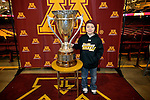skate with Gophers, MacNaughton Cup out of it's glass case.