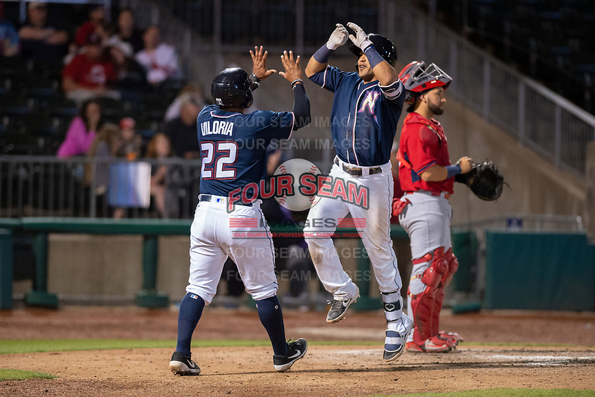 Northwest Arkansas Naturals infielder Angelo Castellano (16) (center) celebrates with catcher Meibrys Viloria (22) after hitting a home run on May 18, 2019, at Arvest Ballpark in Springdale, Arkansas. (Jason Ivester/Four Seam Images)