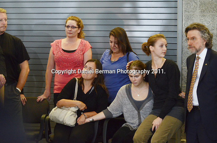 Amanda Knox, right, in gray, is surrounded by friends, family members and her attorney Theodore Simon, following her brief press conference upon her arrival in the United States in Seattle, Tuesday, Oct. 4. Photo by Daniel Berman/www.bermanphotos.com
