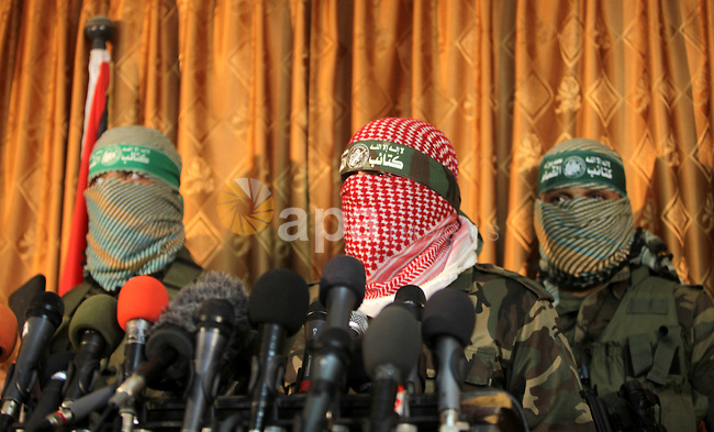 Abu Obeida, Ezzedine al-Qassam Brigades spokesman the military wing of Hamas movement, speaks during a press conference in Gaza city on March 14, 2013.  al-Qassam Brigades announced that it would sue the Egyptian newspaper al-Ahram after it published the names of three Hamas members that, it says, are behind the massacre of 16 Egyptian soldiers last August in the Sinai. Photo by Ashraf Amra