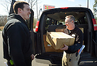 LEVITTOWN, PA - APRIL 17:  Dave Boring (L) and Steve Drobish (R) of Bottom Dollar, load 18 cases of ham into a Salvation Army van April 17, 2014 in Levittown, Pennsylvania. Bottom Dollar is donated 600 Easter meals to needy families. (Photo by William Thomas Cain/Cain Images)
