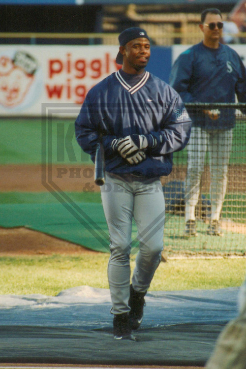 MILWAUKEE - JULY 1997: Ken Griffey Jr. of the Seattle Mariners warms up prior to a game on July 31, 1997 at Milwaukee County Stadium in Milwaukee, Wisconsin. (Photo by Brad Krause)