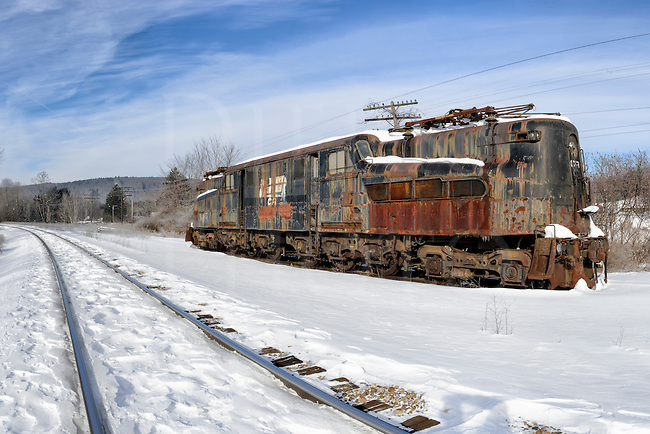 GG1 electric railroad locomotive sitting abandoned in winter snow, former PRR #4917, Penn Central #4934.