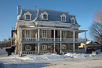 Former convent of Deschambault, built in 1861 and enlarged in 1872 and 1884, now a music school, in Deschambault, Cap Lauzon, on the Chemin du Roy, Quebec, Canada. The convent formed part of a catholic community, including a church, 2 presbyteries, a cemetery and a residents' hall. The Chemin du Roy or King's Highway is a historic road along the Saint Lawrence river built 1731-37, connecting communities between Quebec City and Montreal. Picture by Manuel Cohen