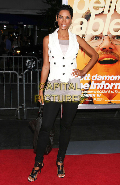 "NICOLE MURPHY .Attending the New York Premiere of ""The Informant!"", New York, NY, USA, .September 15th 2009..full length white sleeveless top waistcoat black leggings sandals open toe bag hand on hip .CAP/LNC/TOM.©LNC/Capital Pictures."